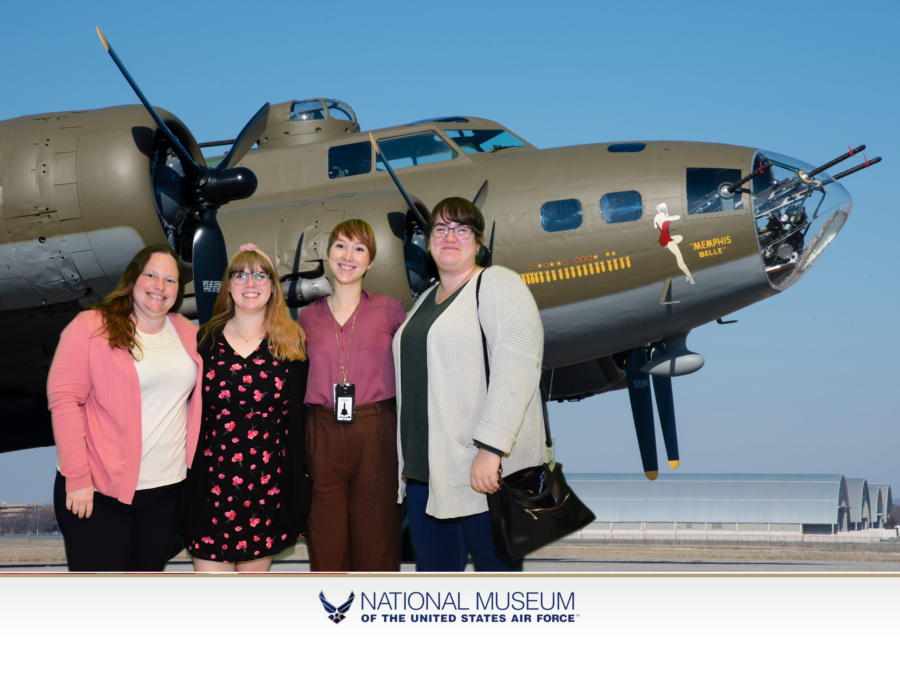 Sample of green screen picture. Four ladies standing in front of the B-17 Memphis Belle.