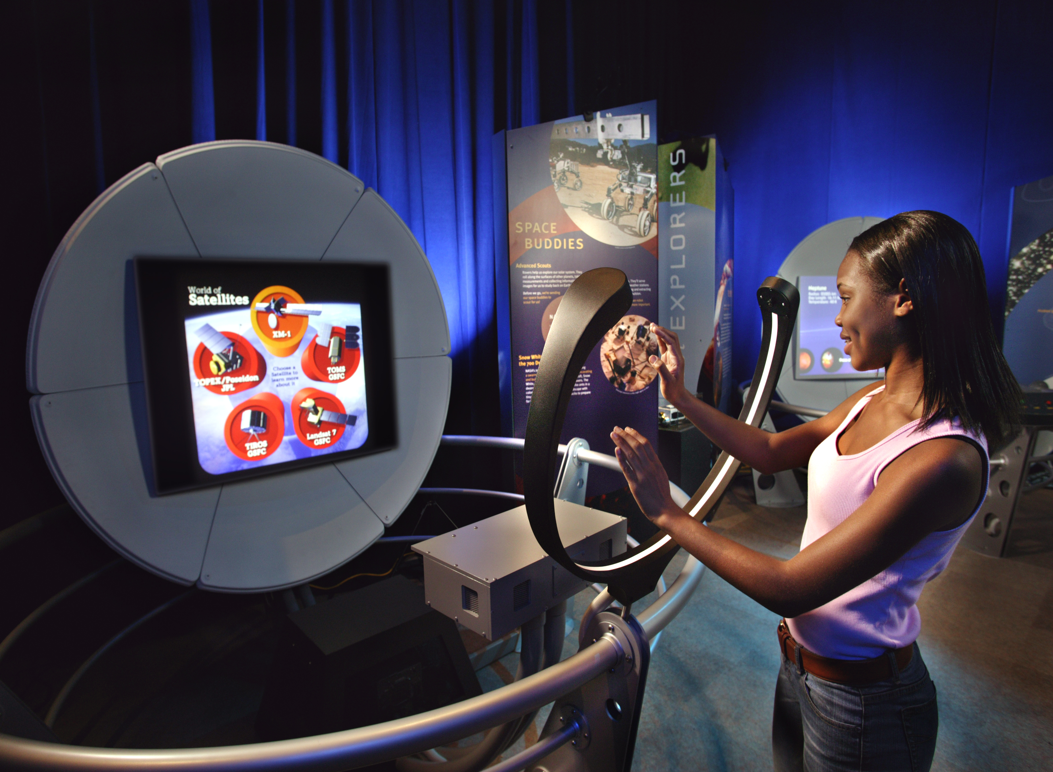 Picture of young lady participating in the Space exhibit