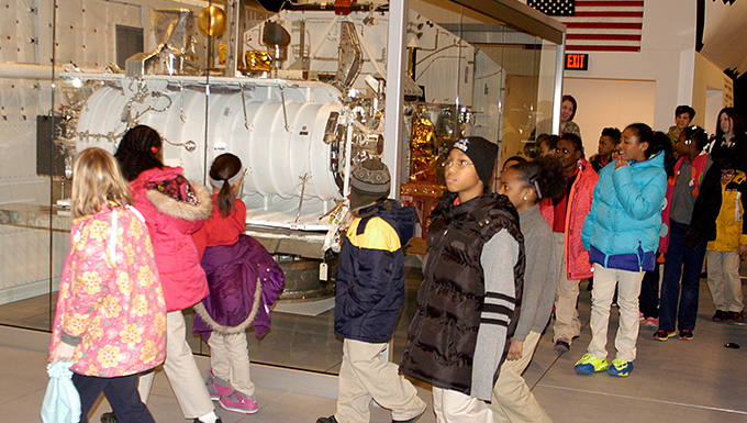 Group of students touring the Space Shuttle Exhibit